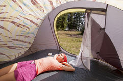 Young woman relaxing in the tent Royalty Free Stock Image