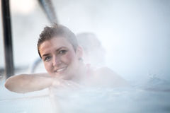 Young woman relaxing in thermal pool. Stock Images
