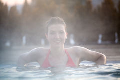 Young woman relaxing in thermal pool. Royalty Free Stock Photos