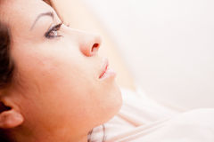 Young woman relaxing and thinking Royalty Free Stock Photos