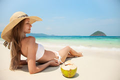 Young Woman Relaxing At Tropical Beach. Young Beautiful Woman Relaxing At Tropical Beach Royalty Free Stock Images