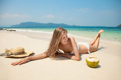 Young Woman Relaxing At Tropical Beach Stock Photo