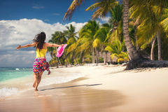 Young woman relaxing on tropical beach Stock Images