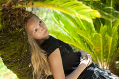 Young woman relaxing on a tropical resort Royalty Free Stock Photo