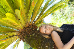 Young woman relaxing on a tropical resort Royalty Free Stock Photography