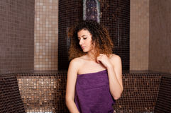 Young woman relaxing in a turkish bath at spa center Royalty Free Stock Images