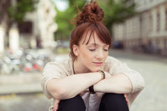 Young woman relaxing in a urban square Stock Photo