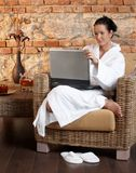 Young woman relaxing, using laptop Stock Photos