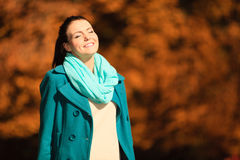 Young woman relaxing walking in autumnal park. Royalty Free Stock Photography