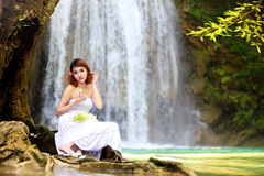 Young woman relaxing in water stream. Near waterfall Royalty Free Stock Photos