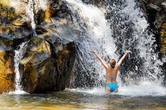 Young woman relaxing in waterfall Royalty Free Stock Images