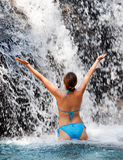 Young woman relaxing in waterfall Stock Photos