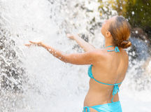 Young woman relaxing in waterfall Royalty Free Stock Photo