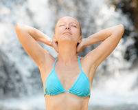 Young woman relaxing in waterfall Royalty Free Stock Photos