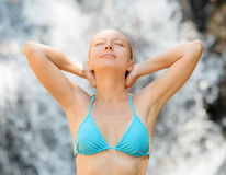 Young woman relaxing in waterfall Stock Image