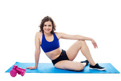 Young woman relaxing after workout Stock Photos