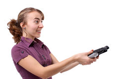 Young woman with a remote control. Woman changing the channel with the remote control Stock Photography