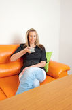 Young woman with remote control Stock Images