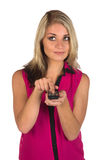 Young woman with remote control Stock Photos