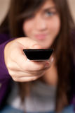 Young woman with remote control close-up Royalty Free Stock Photos