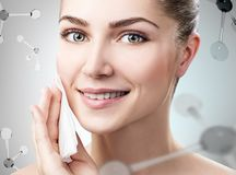 Young woman remove makeup among molecules Stock Image