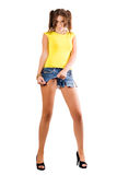 Young woman rending her shorts Stock Photo