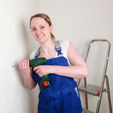 Young woman renovating her home Royalty Free Stock Image