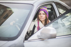 Young woman in a rental car Royalty Free Stock Photos
