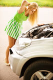 Young woman repairing car Royalty Free Stock Photo