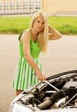 Young woman repairing car Royalty Free Stock Photos