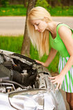 Young woman repairing car Stock Photo