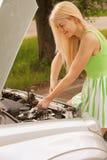 Young woman repairing car Stock Photos