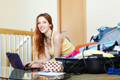 Young woman  reserving tickets on the internet Stock Image