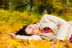 Young woman rest on the autumn leaf Royalty Free Stock Photo