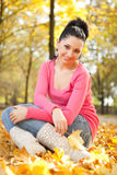 Young woman rest in the autumn park Stock Image