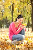 Young woman rest in the autumn park Stock Photo