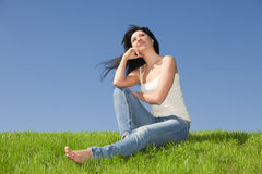 Young woman rest on the grass Royalty Free Stock Images