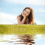 Young woman on the green grass Royalty Free Stock Images