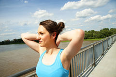 Young woman rest after run with arms over her head. Royalty Free Stock Images