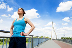 Young woman rest after run, jogging fit in the city. Stock Photos