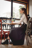 Young woman in restaurant Stock Photography