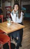 Young woman in restaurant Royalty Free Stock Image