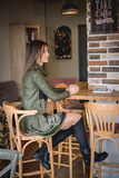 Young woman in restaurant Royalty Free Stock Images