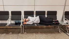 Young woman resting on the airport terminal Royalty Free Stock Photos