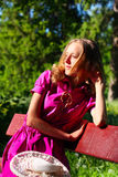 Young woman resting on a bench Royalty Free Stock Photography