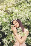 Young woman resting in blossom spring flowers garden Royalty Free Stock Photos