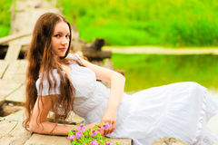 Young woman resting on the bridge of the river Royalty Free Stock Photography