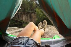 Young woman resting in camping tent,. View from inside royalty free stock photos