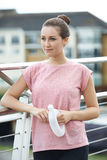 Young Woman Resting On City Bridge During Exercise Royalty Free Stock Images