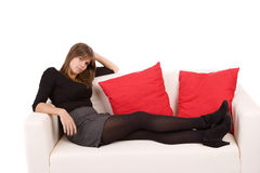 Young woman resting on couch Royalty Free Stock Photos